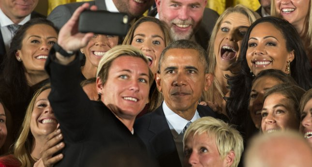 Abby Wambach takes a selfie with her teammates and U.S. President Barack Obama, who honored the U.S. Women's 2015 World Cup champion team at an event in the East Room of the White House in Washington DC on October 27, 2015. Obama said they inspired millions of girls to dream bigger. Photo by Pat Benic/UPI