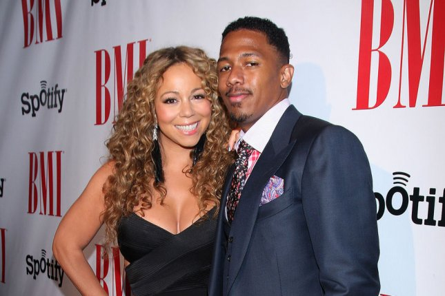 Mariah Carey (L) and Nick Cannon at the BMI Urban Music Awards on September 7, 2012. The couple reunited on Halloween for their kids. File photo by Arnold Turner/UPI