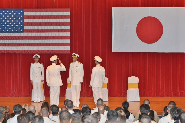 Vice Adm. Robert L. Thomas, commander of U.S. Seventh Fleet, and U.S. Pacific Fleet commander Adm. Scott Swift during a U.S. Seventh Fleet change of command ceremony at the Fleet Activities Yokosuka, in Kanagawa, Japan, on Sept. 7. The United States and Japan said that neither side has plans to launch joint patrols in the South China Sea, even as the two navies conducted a joint training exercise at sea. Photo by Keizo Mori/UPI