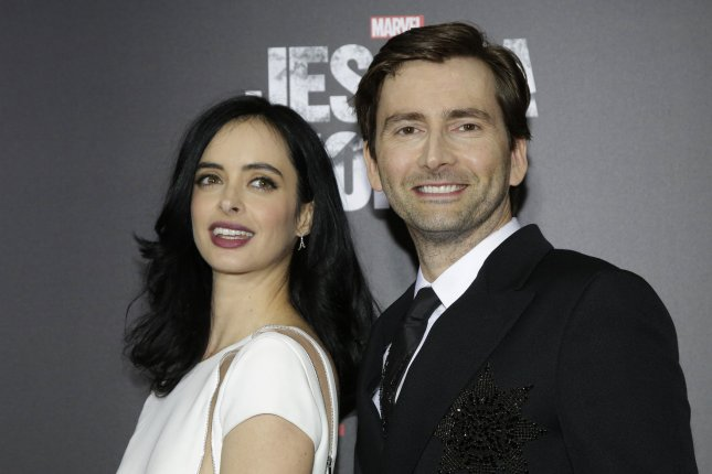David Tennant (R) and Krysten Ritter arrive on the red carpet at the Netflix premiere of new original series Marvel's Jessica Jones on November 17, 2015 in New York City. Tennant will soon be heard on the animated series DuckTales. File Photo by John Angelillo/UPI