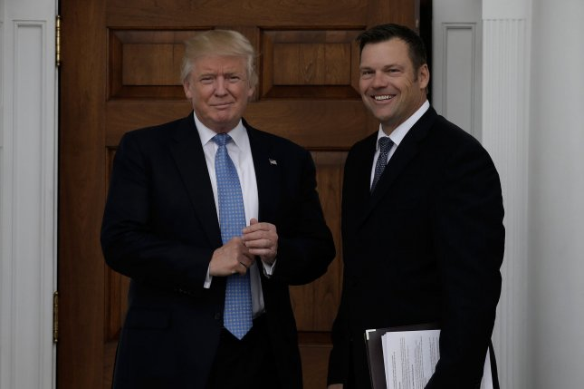 President-elect Donald Trump greets Kansas Secretary of State Kris Kobach at the clubhouse of Trump International Golf Club, in Bedminster, N.J,, on November 20. In May Trump named Kobach vice chairman of the Presidential Advisory Commission on Election Integrity. Pool photo by Peter Foley/UPI