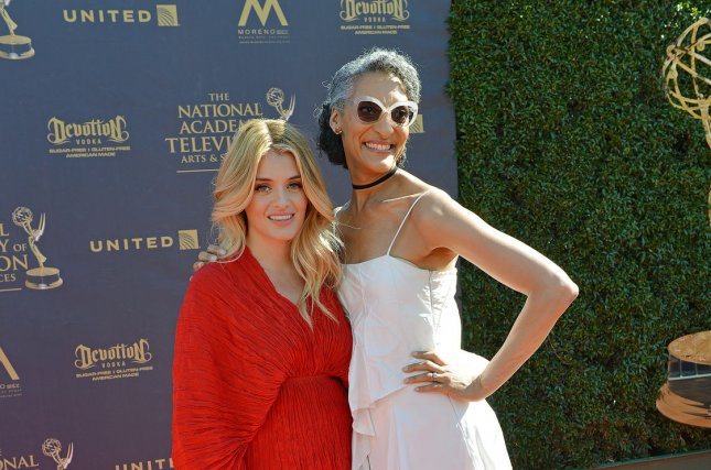 The Chew co-hosts Daphne Oz (L) and Carla Hall arrive at the 44th Annual Daytime Emmy Awards in Pasadena on April 30. Oz will not return for Season 7 of the show. File Photo by Christine Chew/UPI