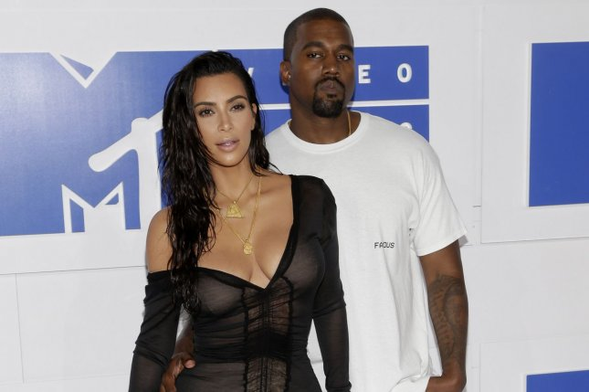 Kanye West (R), pictured with Kim Kardashian, penned a sweet tweet to the reality star on their fourth wedding anniversary. File Photo by John Angelillo/UPI
