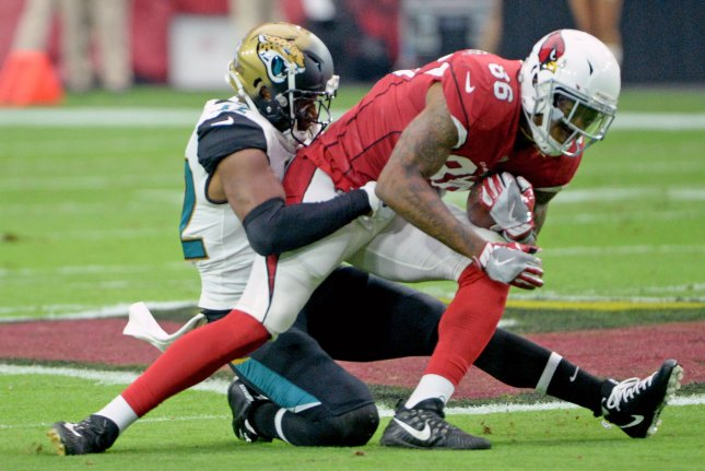 Arizona Cardinals tight end Ricky Seals-Jones (86) is tackled by Jacksonville Jaguars safety Barry Church after a gain of 26 yards in the first quarter on October 15, 2017 at University of Phoenix Stadium in Glendale, Arizona. Photo by Art Foxall/UPI