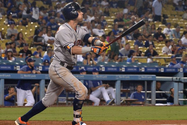 Houston Astros slugger Josh Reddick watches his three-run homer go over the centerfield wall in the eighth inning on August 4 at Dodger Stadium in Los Angeles. Photo by Jim Ruymen/UPI