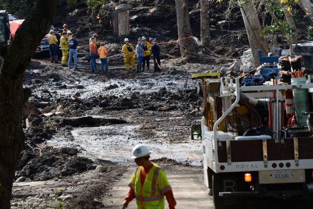 Crews walk through the mud in Montecito, Calif. last January. A mudslide prompted a mandatory evacuation of the Russian River area in Sonoma County Tuesday. Photo by Jim Ruymen/UPI