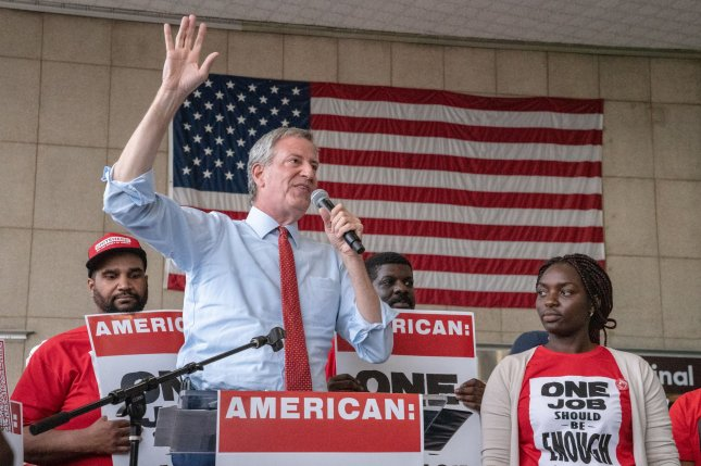 Democratic presidential hopeful Bill de Blasio speaks to workers on July 23 at Reagan National Airport in Arlington, Va. File Photo by Ken Cedeno/UPI