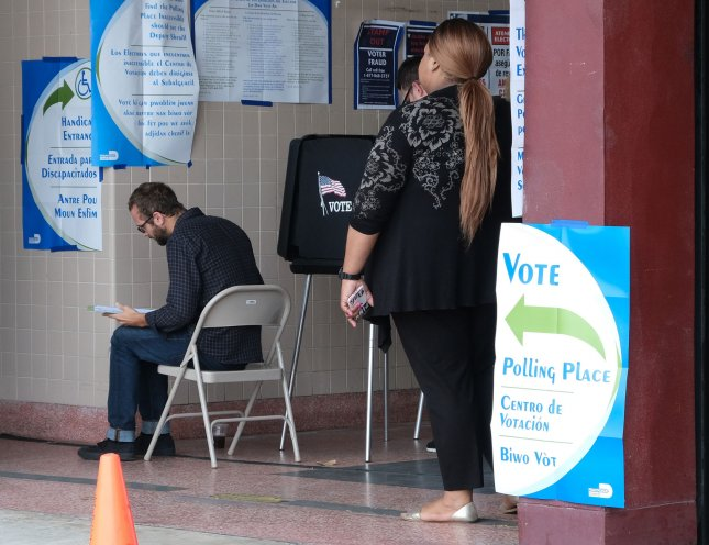 A federal judge ruled that Florida can not block any former felons from voting due to outstanding fees, extending a previous ruling from October that only applied to the plaintiffs. File Photo by Gary I Rothstein/UPI