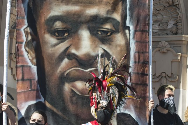 Drummers beat in front of a mural of George Floyd on 18th Street by Delores Park in San Francisco, Calif., on Wednesday. Photo by Terry Schmitt/UPI