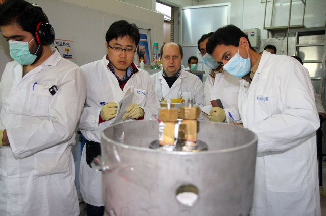 IAEA inspectors examine machinery inside a uranium enrichment plant in Natanz, Iran. Monday, Tehran said parties to the JCPOA have a week to come into compliance or it will limit voluntary IAEA inspections. File Photo by Kazem Ghane/IRNA/UPI