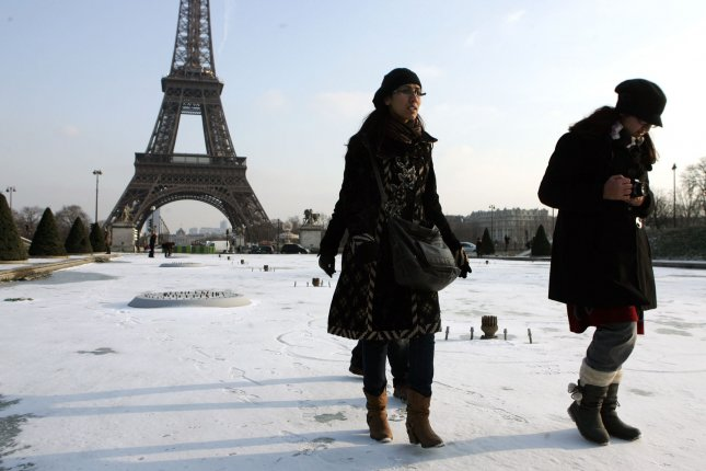 Tourists walk on the frozen waters of the Trocadero fountain in Paris facing the Eiffel Tower, in Paris, Feb. 8, 2012. A cold snap has been sweeping across Europe with sub-zero temperatures, claiming hundreds of lives. UPI/Eco Clement