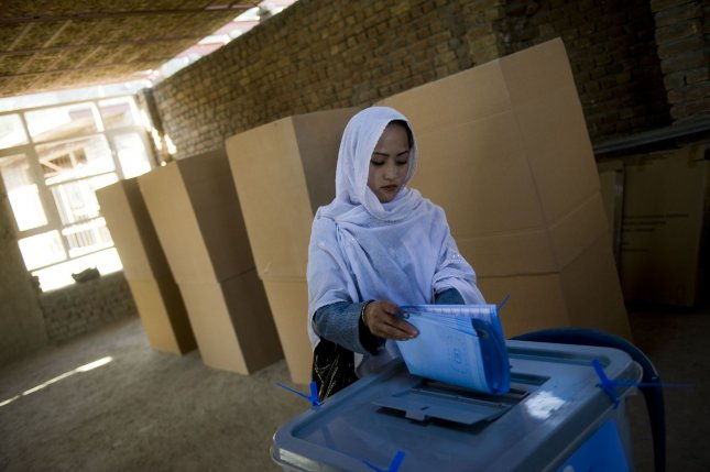 An Afghan woman casts her ballot for the parliamentary elections in Kabul, Afghanistan on September 18, 2010. (UPI/Hossein Fatemi)