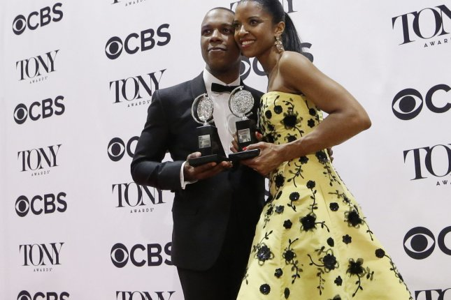 Leslie Odom Jr. and Renee Elise Goldsberry after winning Tony Awards for their performances in Hamilton on June 12, 2016 in New York City. Photo by John Angelillo/UPI