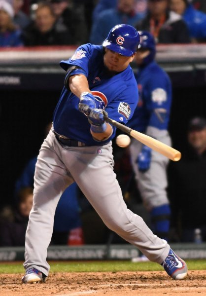 Chicago Cubs' Kyle Schwarber hits an RBI-single against the Cleveland Indians in the fifth inning of game 2 of the World Series at Progressive Field in Cleveland on Wednesday. Photo by Kyle Lanzer/UPI