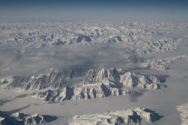 This photograph, taken by the Oceans Melting Greenland (OMG) field campaign team aboard NASA's G-III aircraft on March 26, shows Greenland's massive ice sheet. The OMG team is mapping glacier heights around the entire coast of Greenland for a first-of-its-kind experiment to clarify the picture of how Greenland's glaciers are responding at a time when many signs point to accelerating sea change. Photo by NASA/UPI