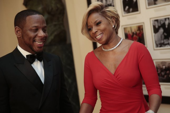 Mary J. Blige (R) is officially divorced from Kendu Isaacs. File Photo by Andrew Harrer/UPI
