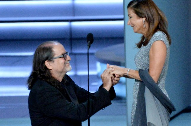 Glenn Weiss (L), winner of the Outstanding Directing for a Variety Special award for The Oscars, proposes marriage to Jan Svendsen onstage during the 70th annual Primetime Emmy Awards at the Microsoft Theater in downtown Los Angeles on Monday. Photo by Jim Ruymen/UPI
