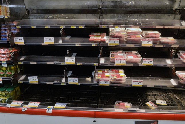 U.S. shoppers face empty meat shelves and supermarkets are setting purchase limits as panic buying and meat production plant shutdowns are disrupting the supply. File photo by Jim Ruymen/UPI