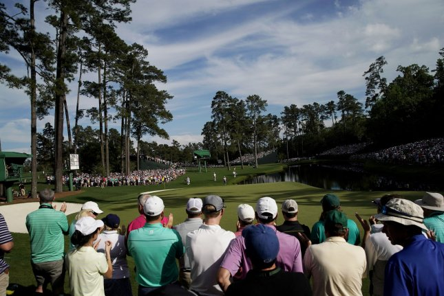 Patrons watch on during the third round of the 2019 Masters Tournament on April 13, 2019, at Augusta National Golf Club in Augusta, Georgia. Fans won't be permitted at this year's event because of the coronavirus pandemic. File Photo by John Angelillo/UPI