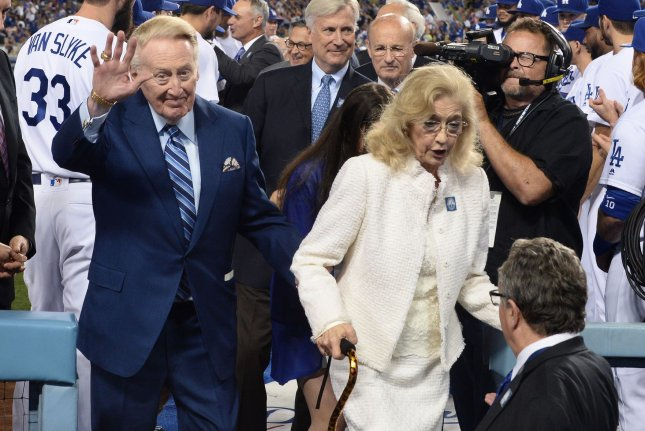 Vin and Sandra Scully, shown in 2016 at Dodger Stadium in Los Angeles, were married for 47 years before Sandra died Sunday from complications of ALS. File Photo by Jim Ruymen/UPI