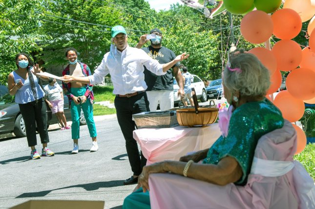 Birthday drive by celebrations, such as this one in Washington, D.C., for 103-year-old Dorothy M. Boggess, are among social distancing efforts some have adopted since the COVID-19 pandemic started -- efforts that are more likely to stick if friends and family do them, too, according to research. File Photo by Kevin Dietsch/UPI