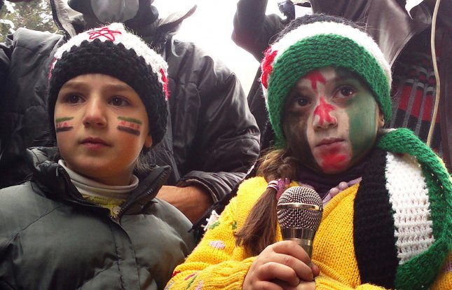 Syrians protest against Syria's President Bashar al-Assad, in Yabroud near Damascus March 2, 2012. More than 10,000 children have died in violence across Syria since anti-regime protests erupted in March 2011, according to the group Save the Children. UPI..