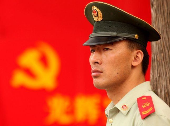 A Chinese soldier watches over an outdoor celebration in the lead-up to July 1, the 90th anniversary of the founding of the Communist Party (CPC) in Beijing on June 28, 2011. Flourishing well in a one-party system, the CPC membership exceeds 80 million, making it the largest political party in the world. Speaking on a visit to Britain, Chinese Premier Wen Jiabao called on Monday for freedom and real democracy in China, despite clamping down on dissent this year. UPI/Stephen Shaver