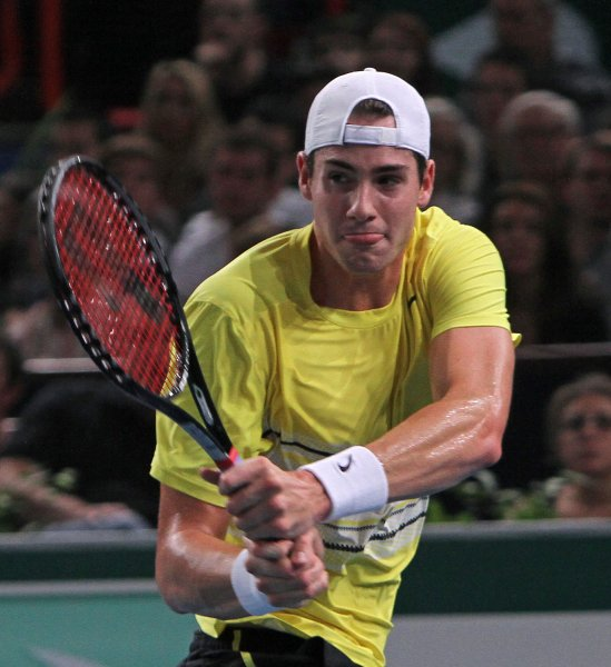 John Isner shown in a match last November, on Sunday won his second singles match of the series to allow the United States to complete a 5-0 sweep of Switzerland in a Davis Cup first-round series. UPI/David Silpa