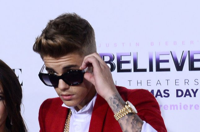 Justin Bieber and his mother Pattie Mallette attend the premiere of Justin Bieber's Believe a backstage and on stage memoir concert film that documents his rise to super stardom at Regal Cinemas in Los Angeles on December 18, 2013. UPI/Jim Ruymen