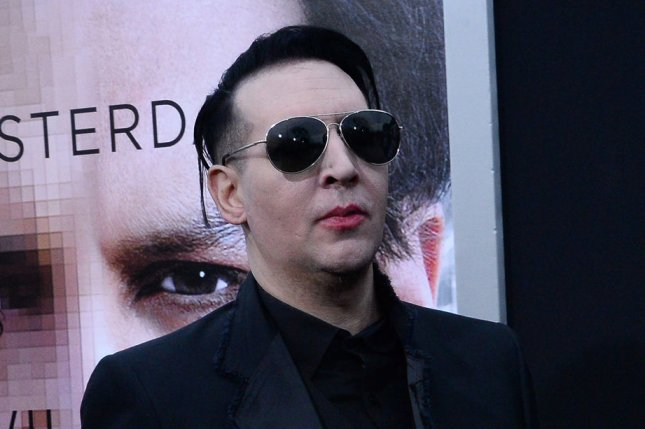 Musician Marilyn Manson and American photographer and fashion model Lindsay Usich attend the premiere of the sci-fi motion picture thriller Transcendence at the Regency Village Theatre in the Westwood section of Los Angeles on April 10, 2014 Storyline: A terminally ill scientist uploads his mind to a computer. This grants him power beyond his wildest dreams, and soon he becomes unstoppable. UPI/Jim Ruymen