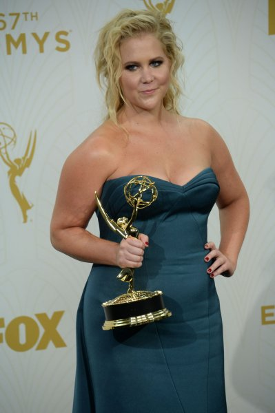 Actress/writer Amy Schumer holds her Emmy for Outstanding Variety Sketch Series for 'Inside Amy Schumer' at the 67th Primetime Emmy Awards in the Microsoft Theater in Los Angeles on September 20, 2015. File Photo by Jim Ruymen/UPI