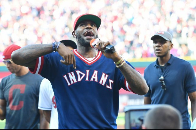 Cleveland Cavaliers' LeBron James speaks to the crowd before the Cleveland Indians face Boston Red Sox in game 2 of the American League Division Series at Progressive Field in Cleveland, Ohio on October 7, 2016. Photo by Kyle Lanzer