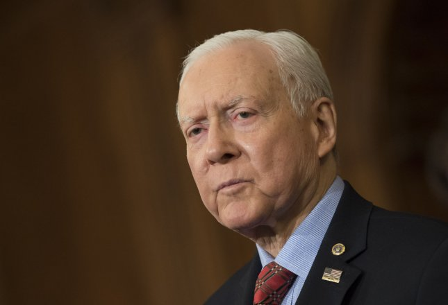 Sen. Orrin Hatch, R-UT, delivers remarks at an enrollment ceremony for 'Tax Cuts and Jobs Act' at the U.S. Capitol Building in Washington, D.C. on December 21, 2017. Hatch's CLOUD Act, which was included int he federal spending bill, gives U.S. law enforcement agencies easier access to Americans' electronic communications. File Photo by Kevin Dietsch/UPI