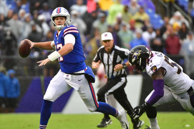 Buffalo Bills quarterback Josh Allen (17) scrambles against the Baltimore Ravens in the third quarter on Sunday at M&T Bank Stadium in Baltimore. Photo by Kevin Dietsch/UPI