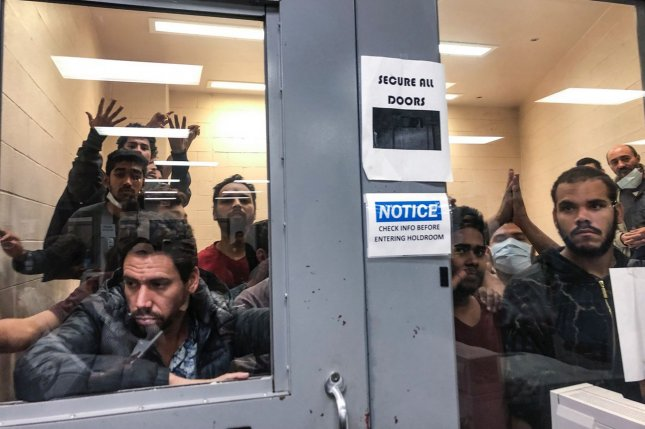 Migrant detainees are seen on July 13 housed in a locked room at the McAllen Border Patrol Station in McAllen, Texas. File Photo courtesy of U.S. Rep. Doris Matsui's office