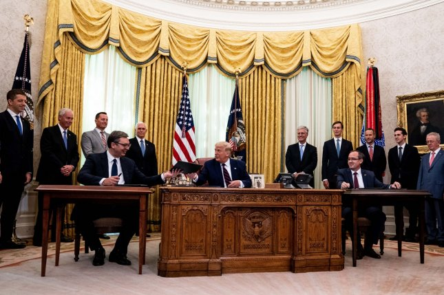 President Donald Trump participates in a signing ceremony and trilateral meeting with Serbian President Aleksandar Vucic (L) and Kovovo Prime Minister Avdullah Hoti on Friday in the Oval Office. Pool Photo by Anna Moneymaker/UPI