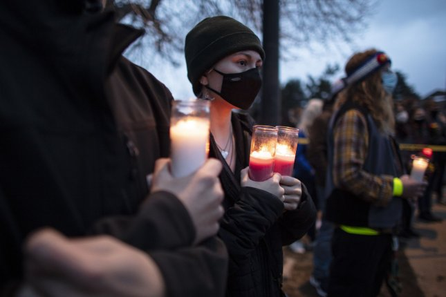 Mourners hold candles during a vigil for the victims of a shooting at a King Soopers grocery store, where 10 people, including a police officer, were killed on March 22 in Boulder, Colo. Photo by Bob Strong/UPI