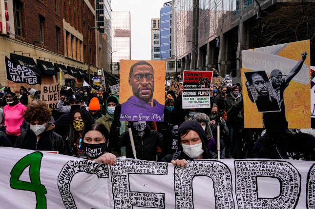 Protesters march through downtown Minneapolis as jury deliberations begin in the Derek Chauvin trial on April 19. The former police officer was convicted for the death of George Floyd. File Photo by Jemal Countess/UPI