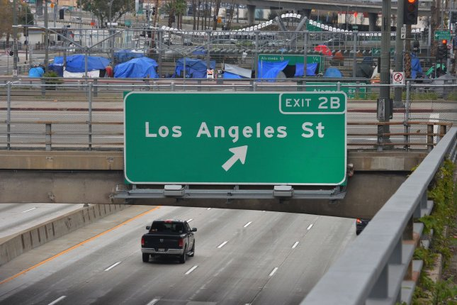 A lone vehicle is seen on a downtown Los Angeles freeway on March 22, 2020 amid a shelter in place order for the state of California due to the COVID-19 pandemic. File Photo by Jim Ruymen/UPI