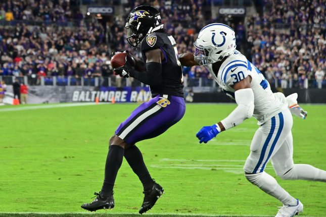 Baltimore Ravens wide receiver Marquise Brown (L) catches the game-winning, 5-yard touchdown pass in front of Indianapolis Colts safety George Odum in overtime Monday night at M&T Bank Stadium in Baltimore, Md. Photo by David Tulis/UPI