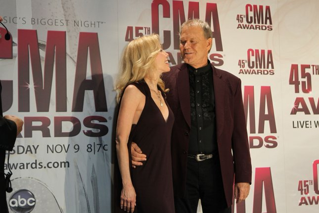 Glen Campbell and his wife Kim pose for photographers. Campbell will be honored with a Lifetime Achievement Award. UPI/Terry Wyatt
