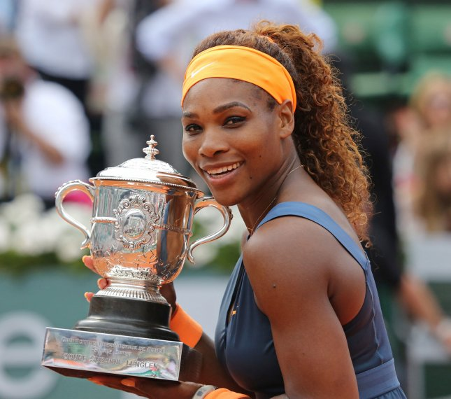 American Serena Williams holds the championship trophy after winning her French Open women's final match against Russian Maria Sharapova at Roland Garros in Paris on June 8, 2013. Williams defeated Sharapova 6-4, 6-4 to win her second French Open title and become the first American woman to win at Roland Garros since she last won the tournament in 2002 . UPI/David Silpa