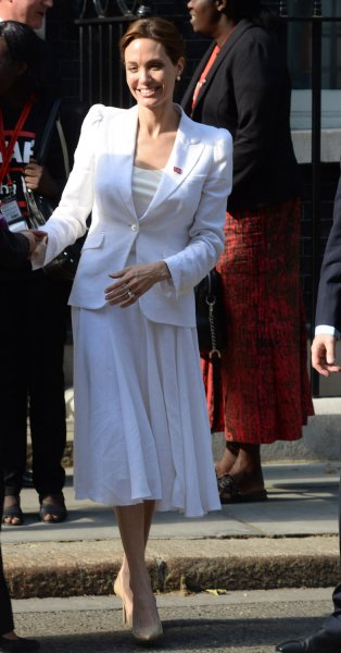 American actress Angelina Jolie attends a meeting on the opening day of the global conference on preventing sexual violence in conflict at No 10 Downing Street in London on June 10, 2014. UPI/ Rune Hellestad