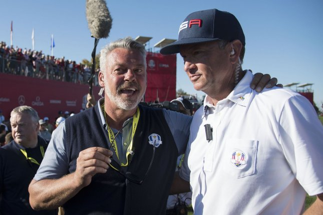 USA team captain Davis Love III (R) embraces European team captain Darren Clarke after the United States defeated Europe to win the 2016 Ryder Cup at Hazeltine National Golf Club in Chaska, Minnesota on October 2, 2016. USA defeated Europe 17-11 winning the Ryder Cup for the first time since 2008. Photo by Kevin Dietsch/UPI