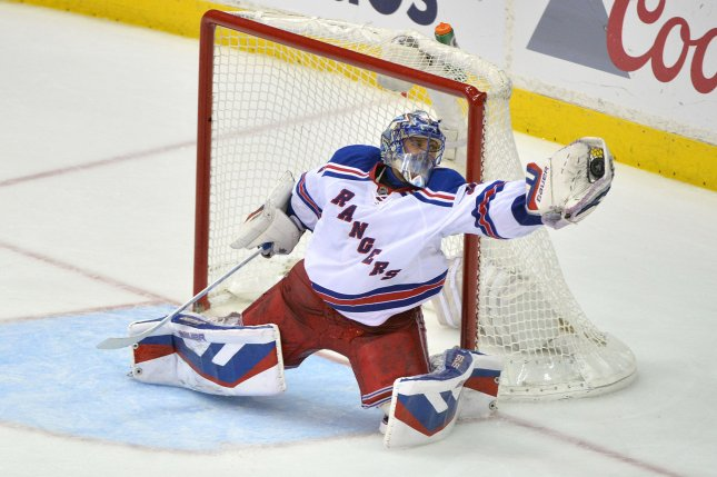 Henrik Lundqvist became just the 12th goaltender to win 400 career games in the National Hockey League on Saturday as the New York Rangers rallied for a 4-2 victory over the Colorado Avalanche in front of a celebratory crowd at Madison Square Garden. File Photo by Kevin Dietsch/UPI