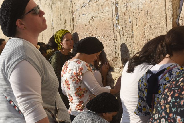 Women pray at the Western Wall, Judaism's holiest site, in the Old City of Jerusalem on Monday. Photo by Debbie Hill/UPI