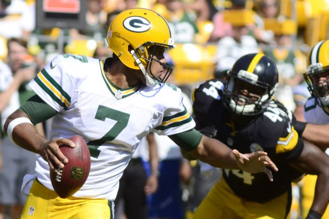 Green Bay Packers quarterback Brett Hundley (7) scrambles away from Pittsburgh Steelers linebacker Howard Jones (44) in the third quarter of the Steelers 24-19 preseason win at Heinz Field in Pittsburgh on August 23, 2015. File photo by Archie Carpenter/UPI