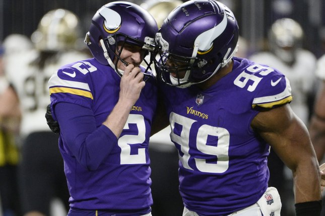 Minnesota Vikings' Danielle Hunter (R) congratulates kicker Kai Forbath after Forbath made a 53-yard field goal during the fourth quarter of the NFC Divisional round playoff game against the New Orleans Saints on January 14 at U.S. Bank Stadium in Minneapolis, Minn. Photo by Brian Kersey/UPI