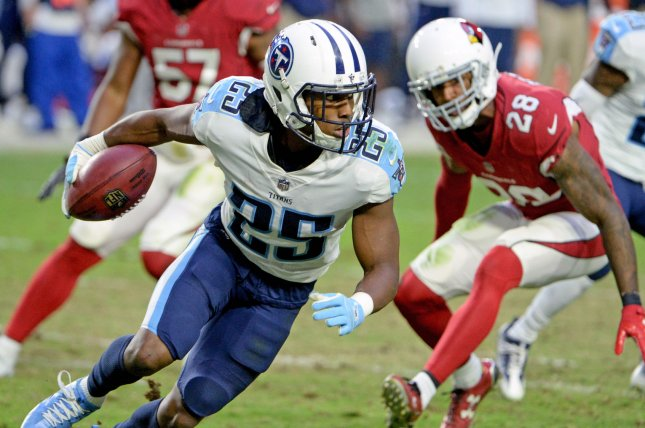 Tennessee Titans' Adoree' Jackson tries to escape tacklers as he returns a punt in the fourth quarter against the Arizona Cardinals on December 10 at University of Phoenix Stadium in Glendale, Ariz. Photo by Art Foxall/UPI