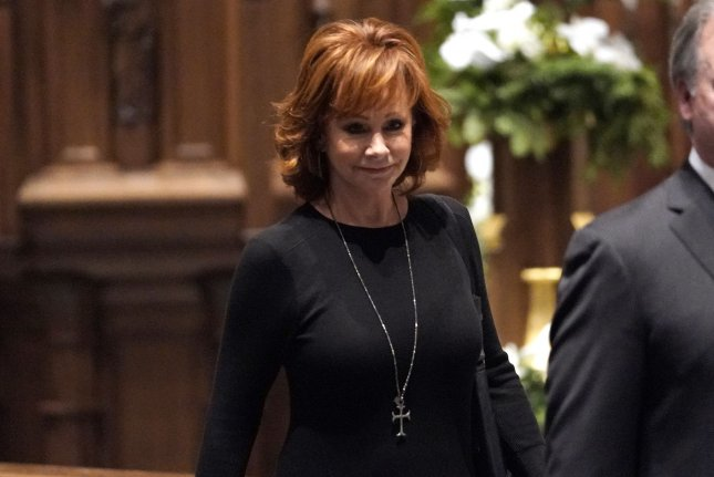 Reba McEntire arrives for a funeral service for former President George H.W. Bush at St. Martin's Episcopal Church in Houston,Texas on December 6. Pool photo by David J. Phillip/UPI